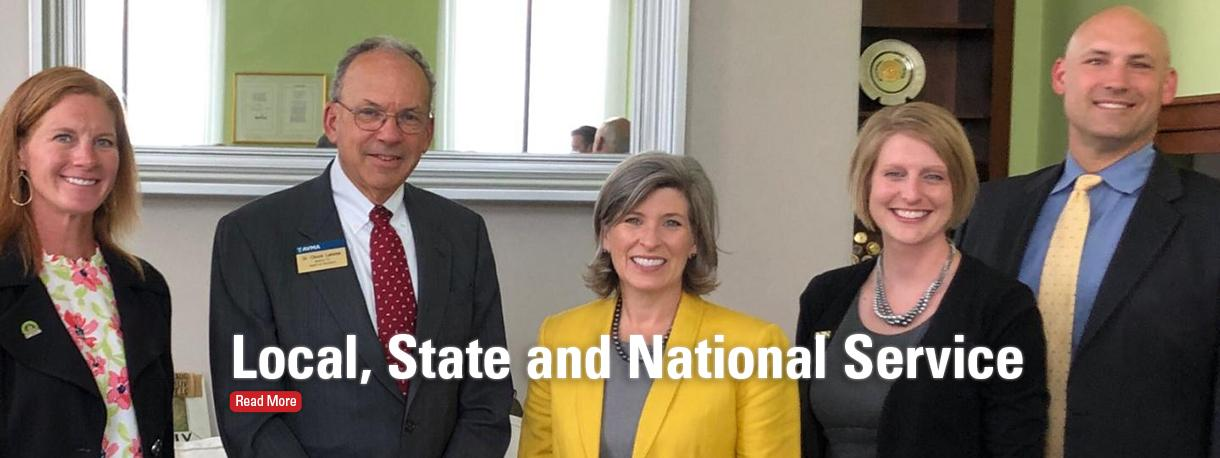 Dr. Charles Lemme with Senator Joni Ernst and others