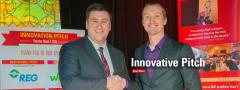 Nick Schmitt receiving Innovation Pitch award