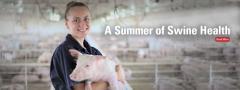 Katie Parker holding pig